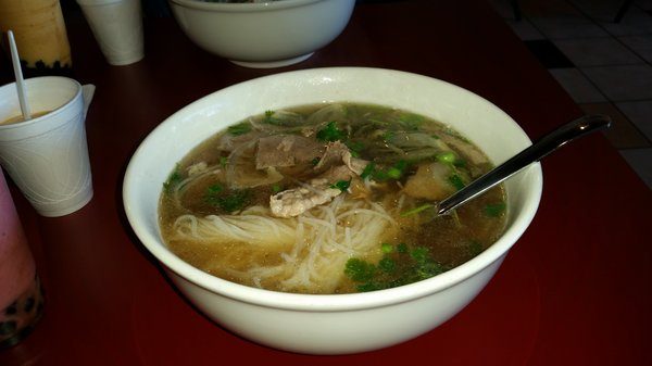 Large bowl of pho, probably one of the best in town.